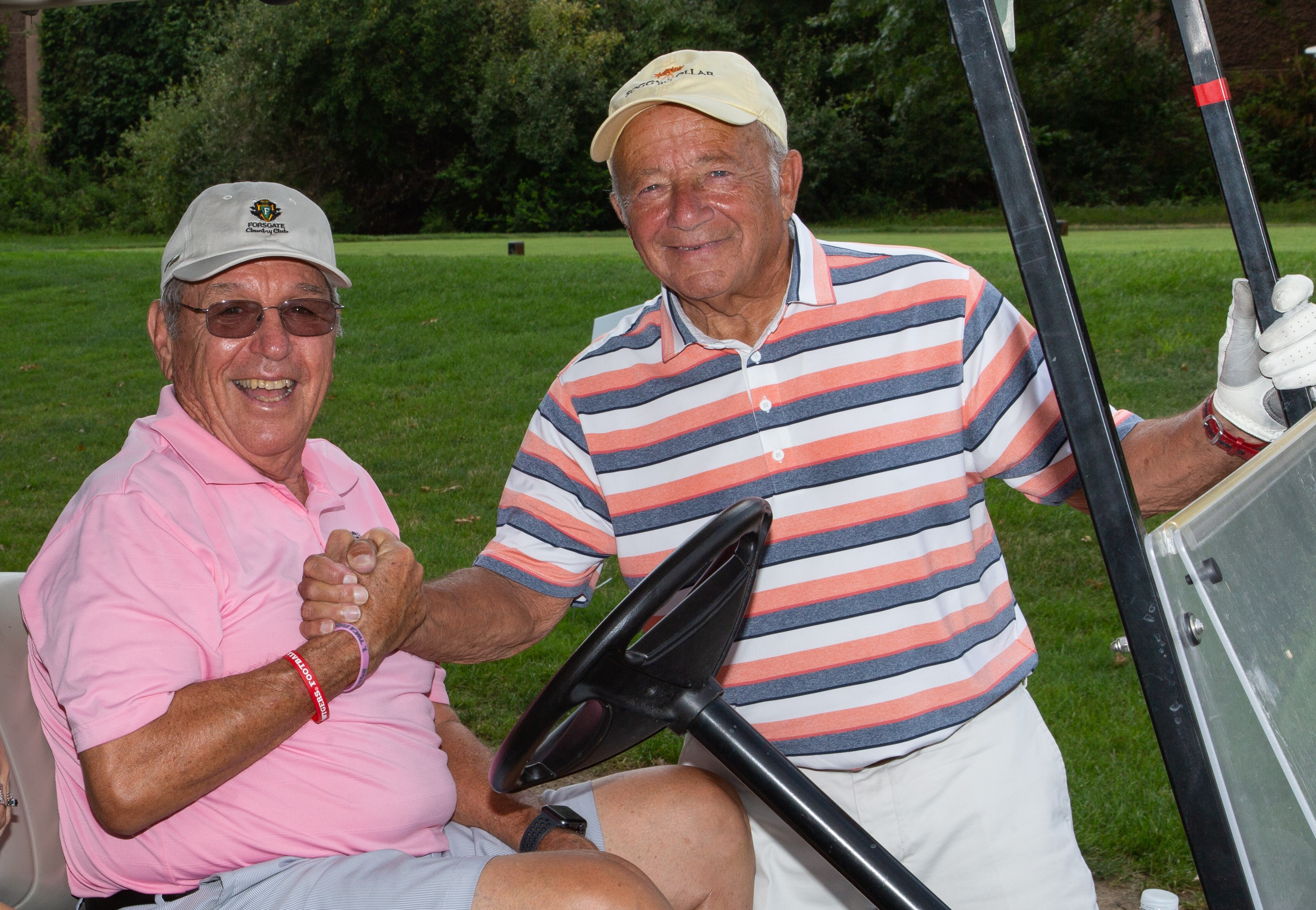 Charles J. Gatt and Martin Galuskin as they participate in the 5th Annual Gatt Golf Tournament